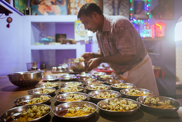 Dishes being plated up for the lunch service at Mani Mess in Trivandrum, Kerala