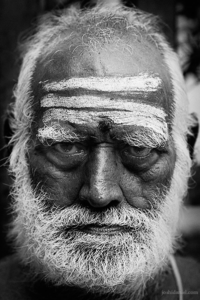 Black and white portrait of an old man in Mylapore, Chennai with vibhuti on his forehead
