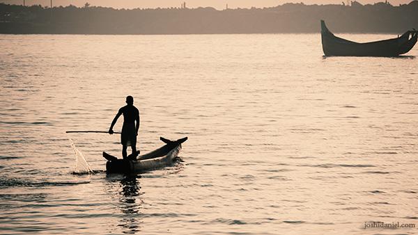 Fisherman rowing the boat in Vizhinjam, Trivandrum