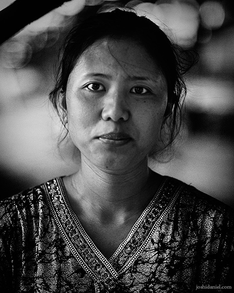 Black and white portrait of a lady smiling in Probolinggo, Indonesia