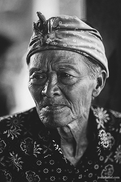 Black and white portrait of an old man in Uluwatu, Bali, Indonesia