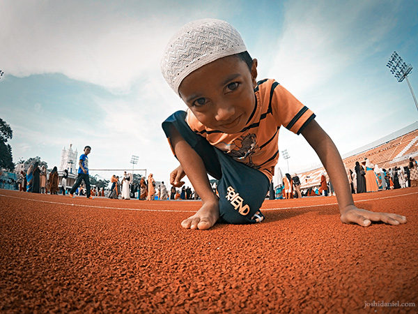A young boy curiously looks at my GoPro during the morning Eid prayer at Chandrasekharan Nair Stadium in Trivandrum, Kerala