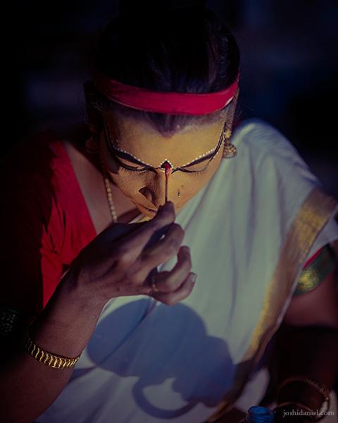 Nangiarkoothu artist Margi Usha doing make-up