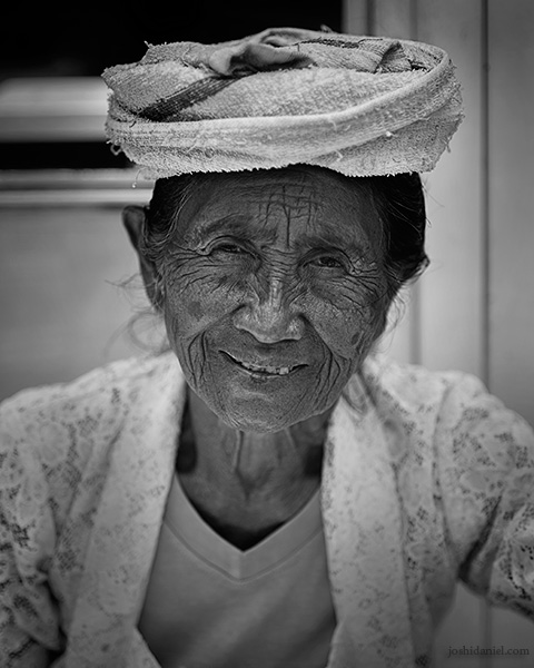 Black and white portrait of a smiling lady in Ubud, Bali