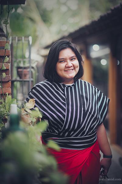 Portrait of of a smiling Elsa Silvana Fransisca wearing a Lulu Lufti Labibi design in Yogyakarta, Indonesia