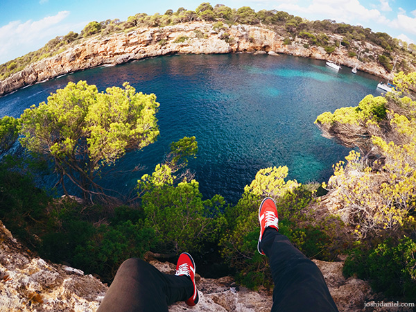 A GoPro Hero5 black self-portrait of joshi daniel's feet hanging from the edge of a cliff near Cala Pi, Mallorca (Majorca), Spain.
