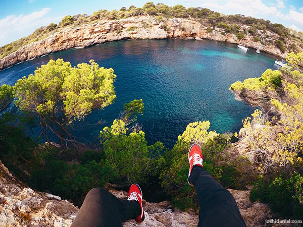 A GoPro Hero5 black self-portrait of joshi daniel's feet hanging from the edge of a cliff near Cala Pi, Mallorca (Majorca), Spain.