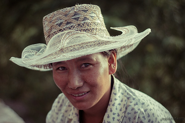 Portrait of a smiling woman in McLeod Ganj, Himachal Pradesh wearing a hat