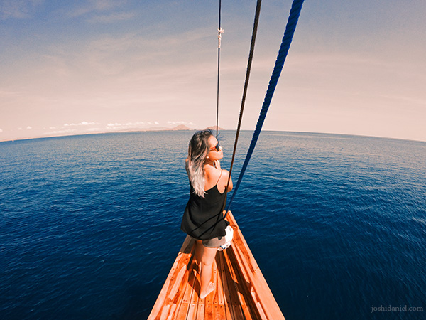 Hanny Kusumawati by the bow of the boat Enroute to Kanawa Island, Indonesia