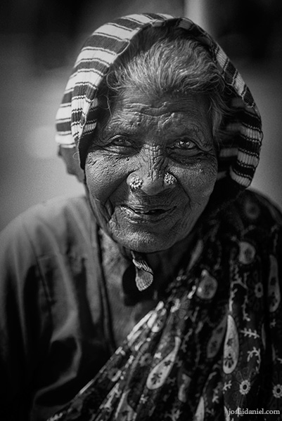 Black and white portrait of a smiling old lady in Chennai, India