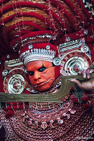 Portrait of muchilottu bhagavati theyyam performer holding a sword in Kannur, Kerala