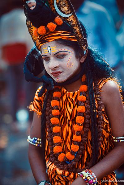 A young boy dressed as the Hindu deity Shiva at the Nashik Kumbh Mela