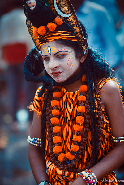 A young boy dressed as the Hindu deity Shiva at the Nashik Kumbh Mela