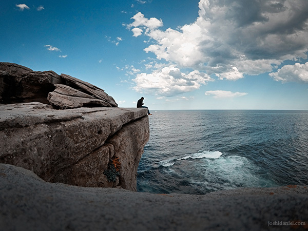 Self-portrait of joshi daniel sitting on the cliff by Bondi beach in Sydney, New South Wales, Australia