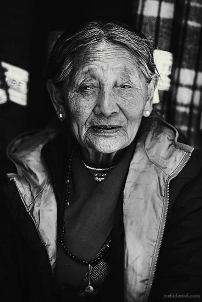 Black and white portrait of an old woman from McLeod Ganj, Dharmsala, Himachal Pradesh