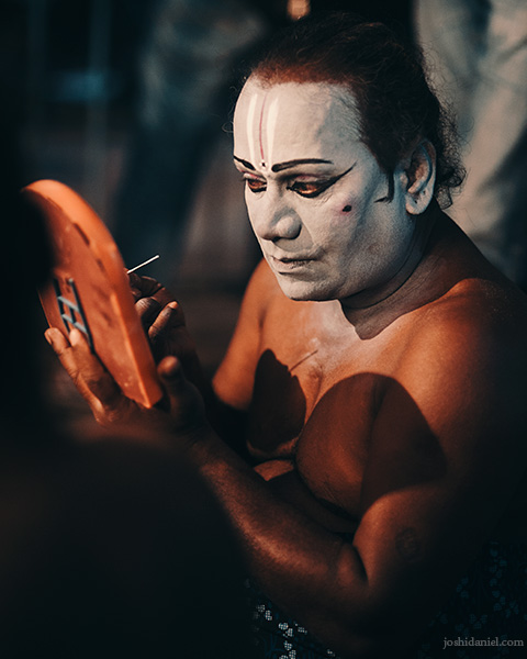 Portrait of a Kattai koothu artist doing his make-up before a performance in Chennai, Tamil Nadu, India