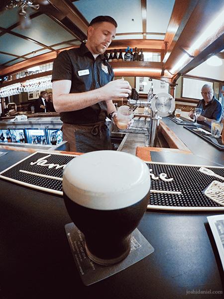 A GoPro photo of a bartender serving up beer at Fortune of War, Sydney, Australia
