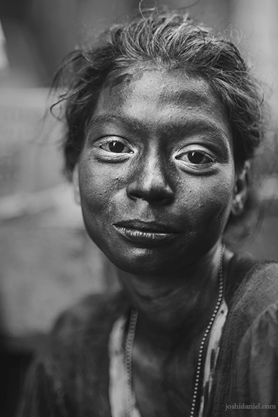 Black and white portrait of a girl covered in Holi colours in Sowcarpet, Chennai, Tamil Nadu, India