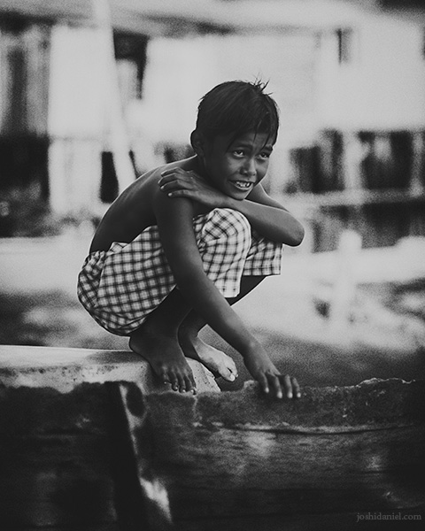 Black and white portrait of a boy from Senggarang Village, Indonesia