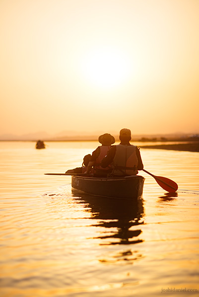 People going on a canoe ride in Satpura National Park at sunset