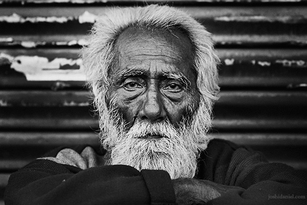 Black and white portrait of an old bearded man in Allahabad, Uttar Pradesh, India