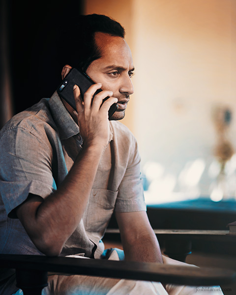 Portrait of Malayalam film actor Fahadh Faasil talking on the phone in Ernakulam, Kerala, India
