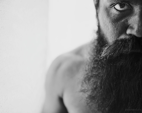 Black and white Self-portrait of joshi daniel with a beard taken on a 28mm lens in Trivandrum, Kerala, India