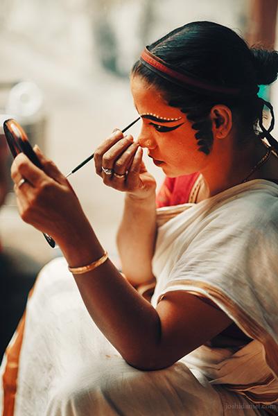 Kutiyattam (Koodiyattam) artist Kalamandalam Sindhu applying make-up during a performance in Trivandrum, Kerala, India