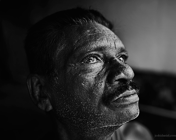 A 28mm wide angle black and white portrait of a man looking up