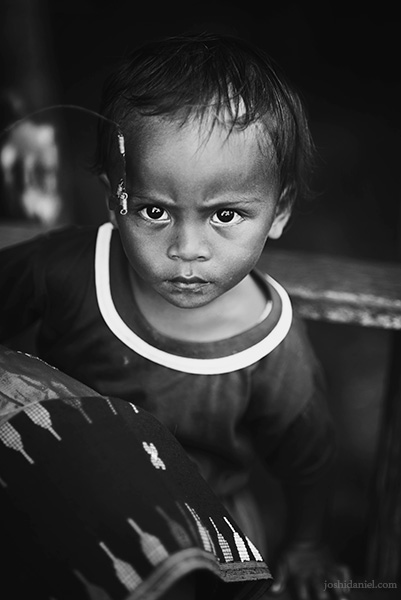 Black and white portrait of a young boy from Melo village, Flores, East Nusa Tenggara, Indonesia