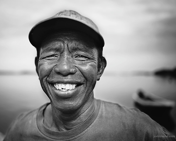 28mm black and white portrait of a smiling fisherman from Debut Port, Kei Island (Kai Island), Maluku, Indonesia