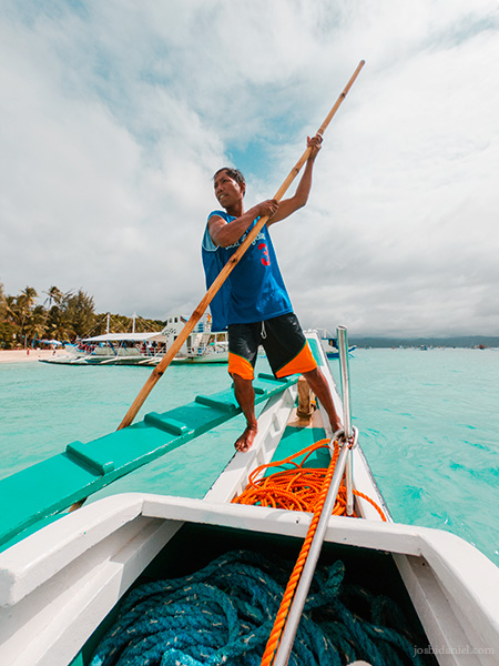 Portrait of a man rowing a boat in White Beach, Boracay, Philippines