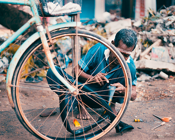 Bicycle repair on the road in Chennai, Tamil Nadu, India