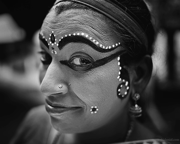 A 28mm wide angle black and white portrait of Nangiarkoothu artist Margi Usha.
