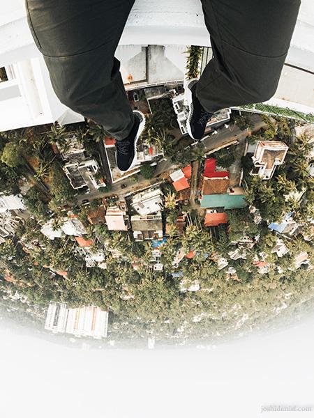 GoPro shot of joshi daniel's feet dangling above the cityscape of Trivandrum, Kerala, India