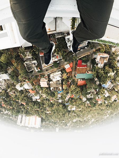 GoPro shot of joshi daniel's feet dangling above the cityscape of Trivandrum, Kerala, India