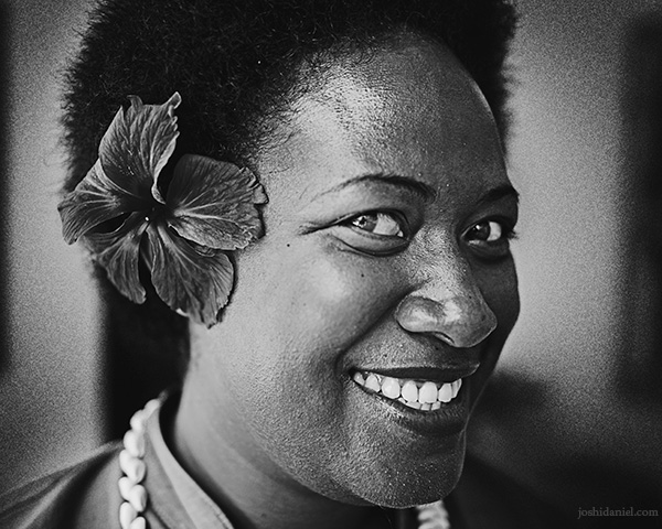 A 28mm wide angle black and white portrait of a smiling Fijian lady from Paradise Cove Resort, Naukacuvu Island, Fiji