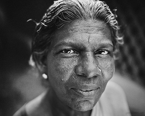 A 28mm wide angle black and white portrait of a smiling lady from Trivandrum, Kerala, India