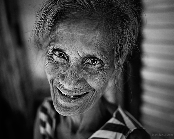 A 28mm wide angle black and white portrait of a cute street vendor in Binondo, the world's oldest Chinatown which is in Manila, Philippines