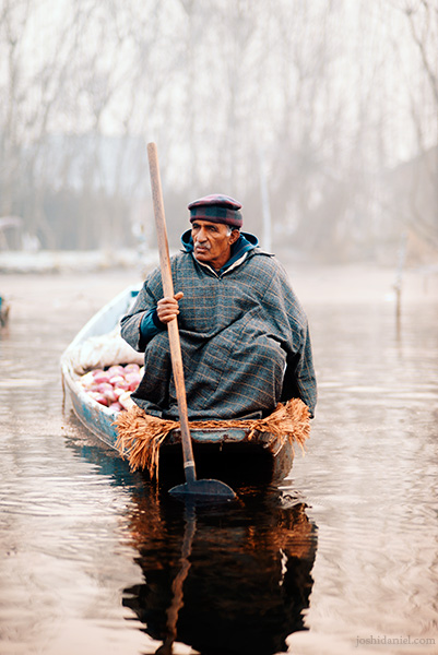 Portrait of a vegetable seller from the floating vegetable market in Dal Lake, Srinagar, Jammu and Kashmir, India