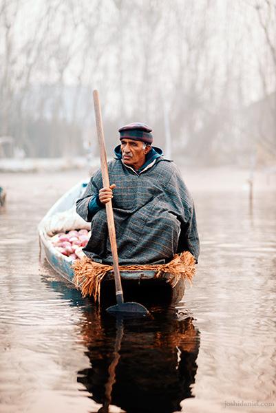 Portrait of a vegetable seller from the floating vegetable market in Dal Lake, Srinagar, Jammu and Kashmir, India