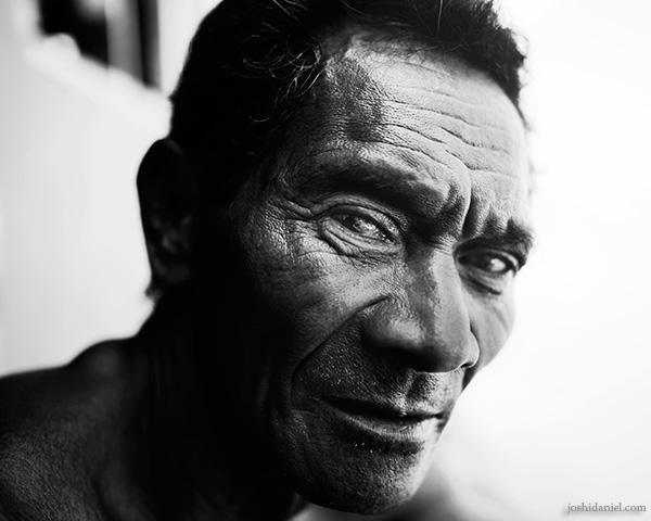 A 28mm wide angle black and white portrait of a man from Rainbow Village, Tual, Maluku, Indonesia