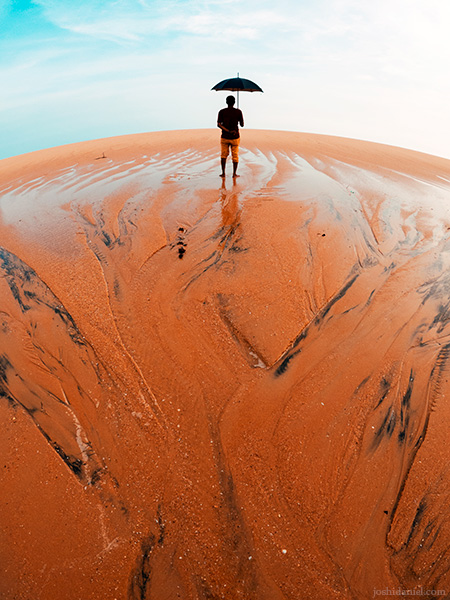 A GoPro photo of Chandrakanth C K holding an umbrella and standing at the seashore in Trivandrum, Kerala, India