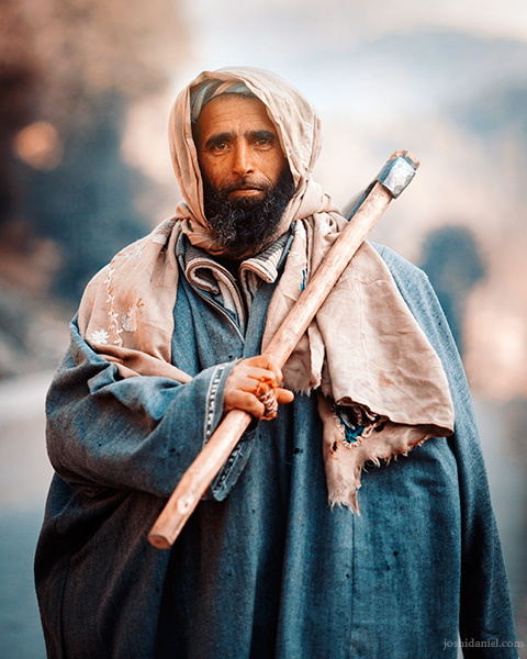 A Kashmiri man out at work and holding an axe in Anantnag, Jammu and Kashmir, India