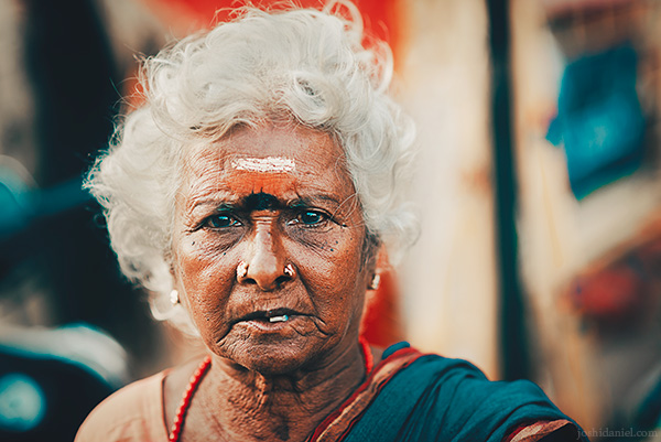 Portrait of a frowning old woman in Sowcarpet, Chennai, Tamil Nadu, India