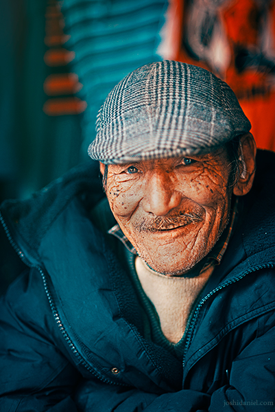 Portrait of a smiling roadside shopkeeper in Mcleod Ganj, Dharamsala, Himachal Pradesh, India