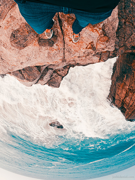 GoPro self-portrait of joshi daniel on the edge of a cliff by the sea in Trivandrum, Kerala, India