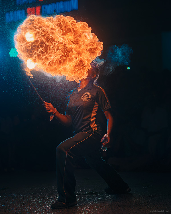 A girl performing a fire eating stunt during the Mylapore, Chennai, Tamil Nadu, India