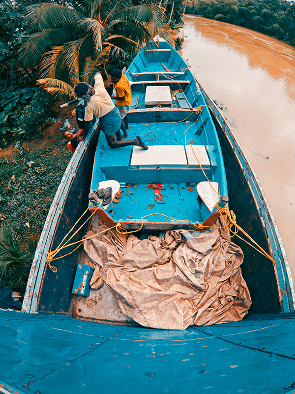 Fishermen at work in Thiruvalla, Kerala, India, after finishing the Kerala Flood Rescue operation to transport it back to Trivandrum