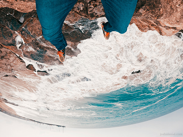GoPro shot of joshi daniel's feet dangling from the edge of a cliff in Trivandrum, Kerala, India